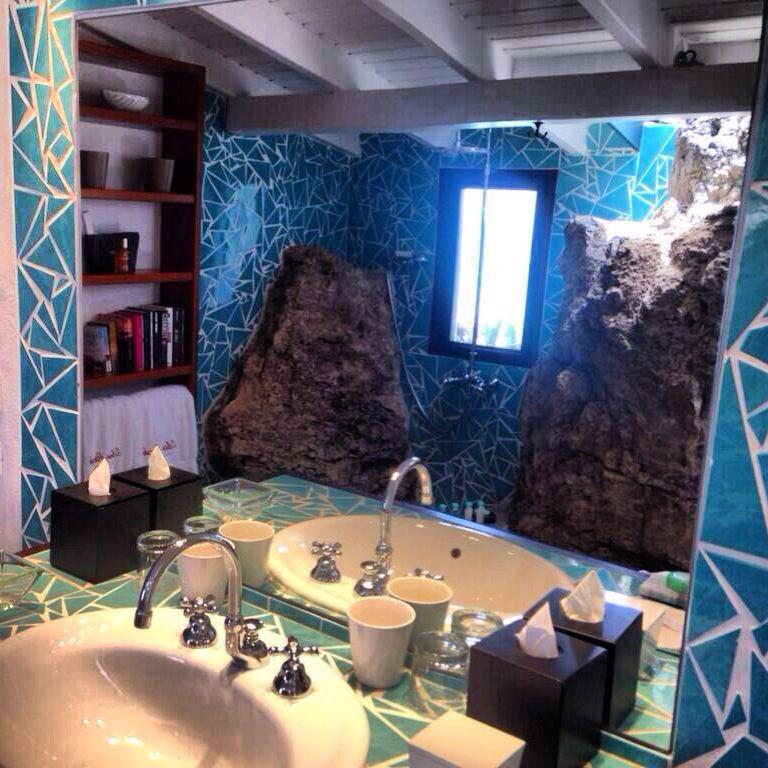 A luxury bathroom at st barths eden rock built into the for Caribbean bathroom ideas