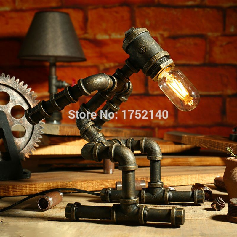 Photo of LOFT industrial iron water pipe desk lamp athlete robot lamp…