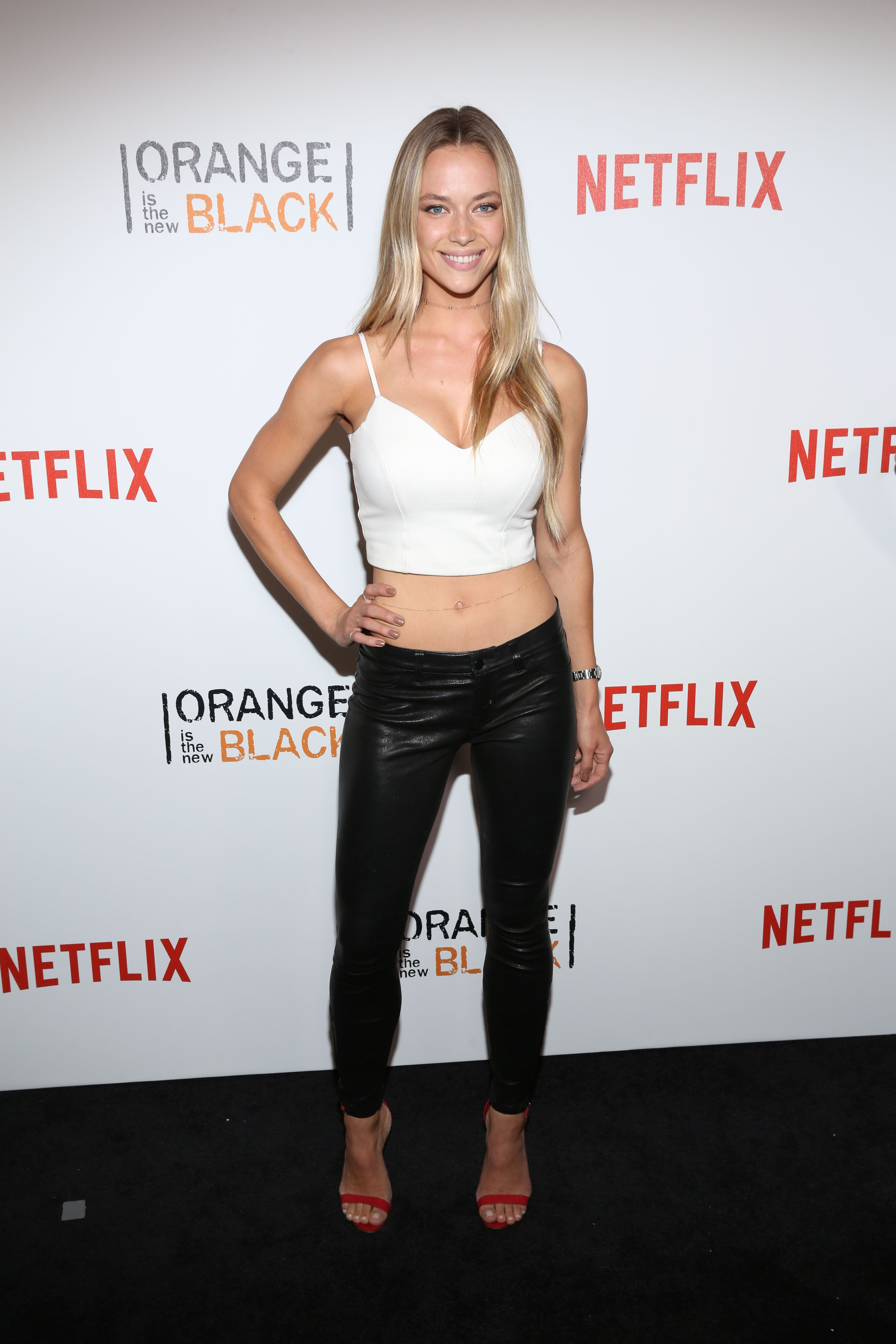 f326146aaf97 American fashion model Hannah Ferguson showed off her impressive figure in  skintight leather pants and a sleeveless crop top as she attended the   Orange…