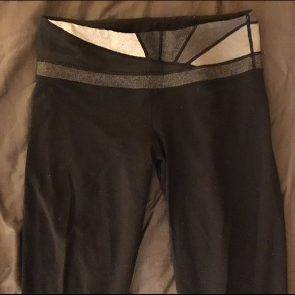 Lulu lemon yoga pants Black lululemon yoga pants. Normal wear-have had them for two years. Very minimal pulling on back. Barely noticeable. lululemon athletica Pants Boot Cut & Flare