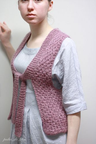 It's a tiny cute vest with long armholes and without any side seams. Long strings go over to collar, what makes vest very feminine and cosy. It's easy and quick to knit!