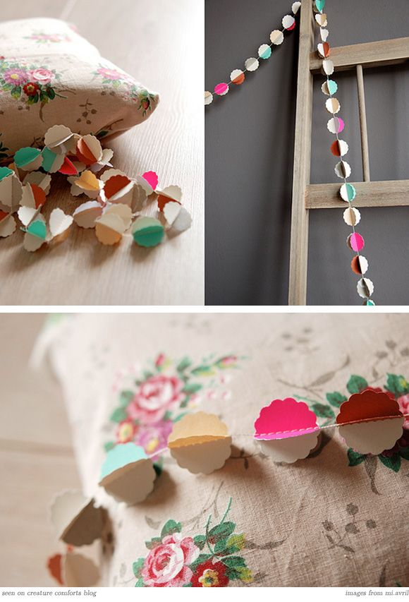Love this for a Spring garland.  I made one of these before--- I just punched out shapes from card stock that is colored on both sides, stacked two shapes together, ran through my sewing machine down center of shape, lightly bent inward toward sewn seam, voila!
