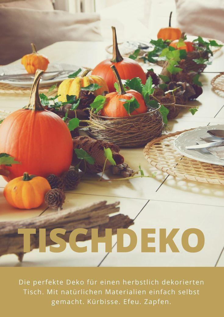 Herbstliche Tischdeko mit Kürbis, Efeu und Zapfen ...
