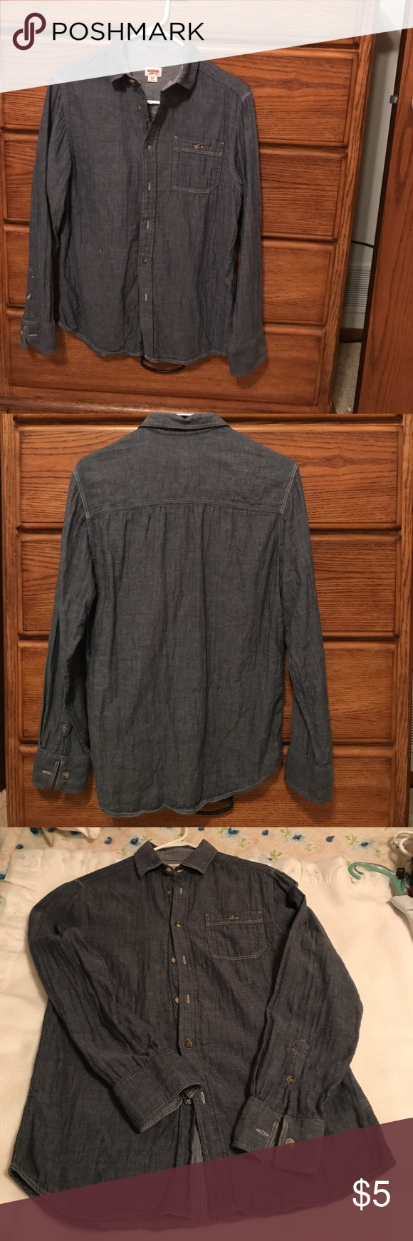 Mossimo young men's long sleeve denim button down Denim button down. Soft and broken in. Great for back to school. Made from recycled plastic. Small fray on lower front right side. Cannot really see it from a distance. See photo. Priced accordingly. Mossimo Supply Co Shirts Casual Button Down Shirts