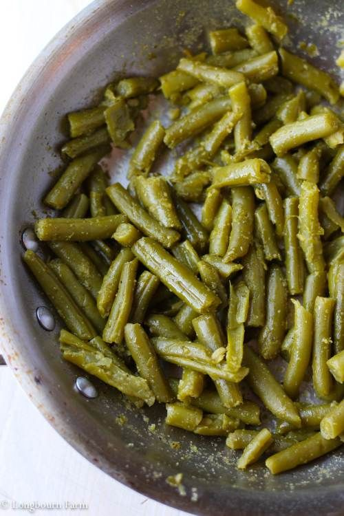 Cooked canned green beans in a pan. (With images) | Easy ...