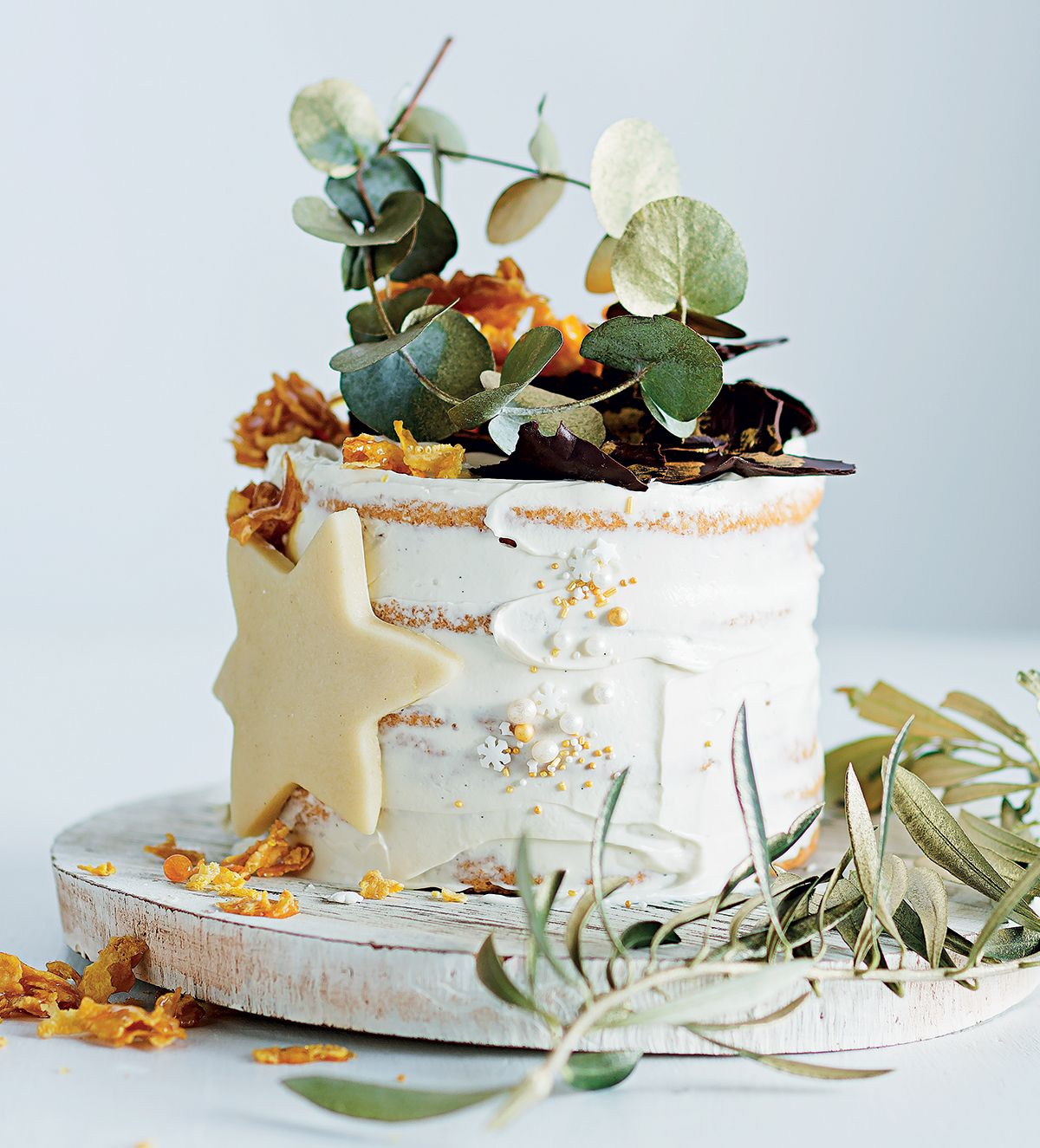 Meringue cake with cream cheese icing and caramel cornflake crown ...