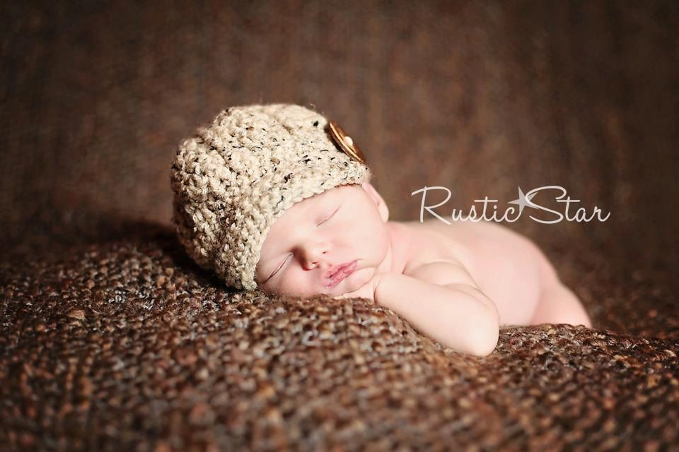 Newborn Newsboy Hat with large oversized brown wooden button visor beanie photography prop by HappyHooksCrochet. $18.95, via Etsy.