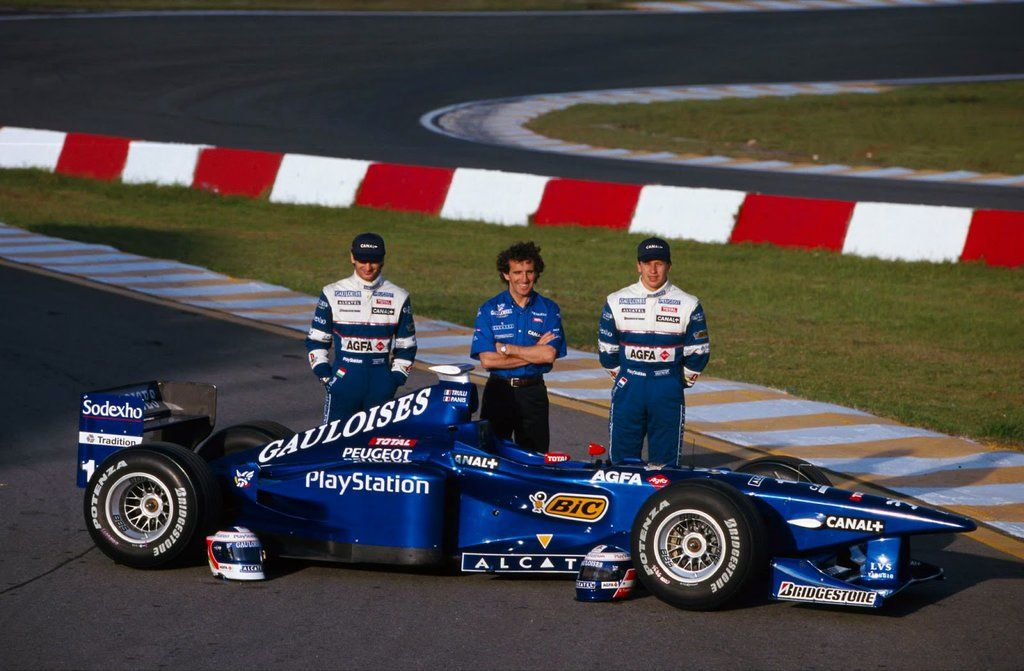 Jarno Trulli, team-owner Alain prost and Olivier Panis with their 1998 challenger, the Peugeot-powered Prost AP01.  1998 Brazilian Grand Prix, Autódromo José Carlos Pace (Interlagos)