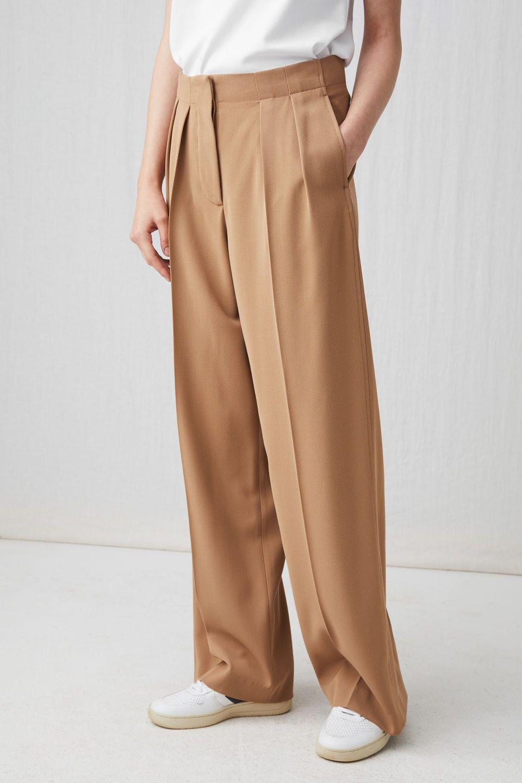 cc94dc56 Model side image of Arket wide fluid wool trousers in beige Black Trousers, Trousers  Women