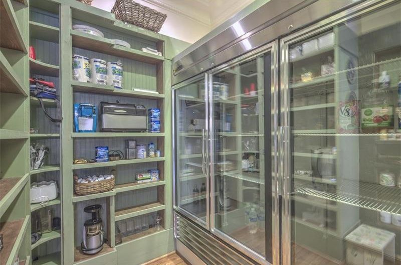 This Walk In Pantry Is Made More Functional By The Inclusion Of A Huge Refrigerator Both Non Refrigerated And Kitchen Pantry Design Pantry Room Pantry Design