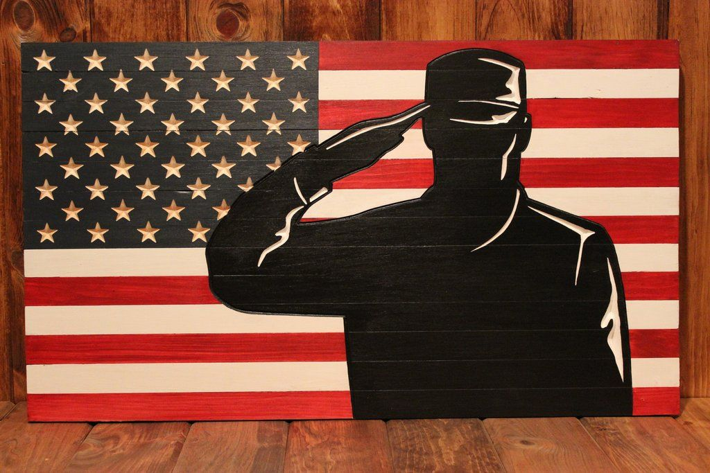 traditional american flag with saluting soldier silhouette engraved