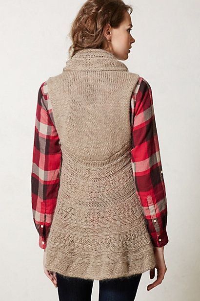 Make something like this - stockinette back, CO stitches, pickup stitches around bottom back, CO stitches for other front, pickup stitches across neck (?), knit in the round, some interesting lace panels. I wonder if Rav has something similar already.