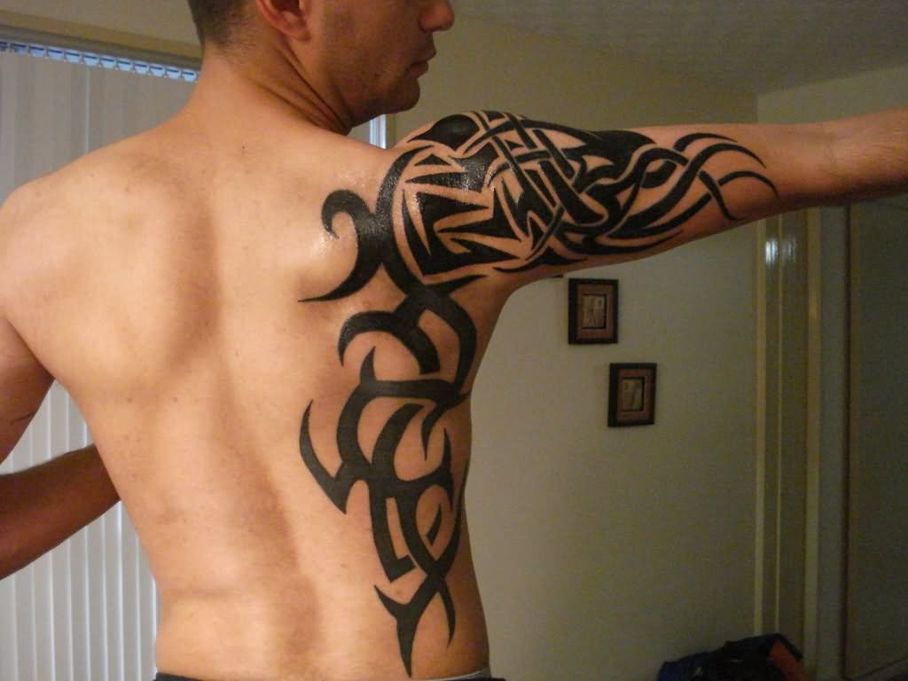 Man Right Sleeve And Back Tribal Tattoo Tribal Tattoo Designs Tribal Tattoos For Men Tribal Tattoos Cool Tribal Tattoos