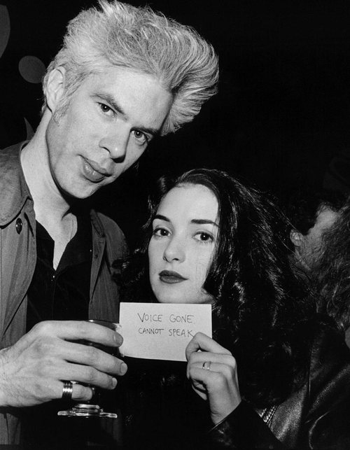 """Jim Jarmusch and Winona Ryder. She's written: """"Voice Gone, Can't Speak"""". Photographed during/immediately after the filming of Night on Earth (1991)."""