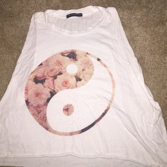 Top Ying yang flowered and white mussle top!  Super comfy and light worn once but in great condition and washed  Brandy Melville Tops Muscle Tees