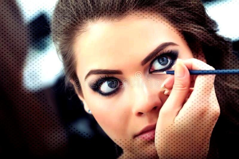 liquid eyeliner. Make-up artist applying liquid eyeliner with brush, cl ,Applying liquid eyeliner.