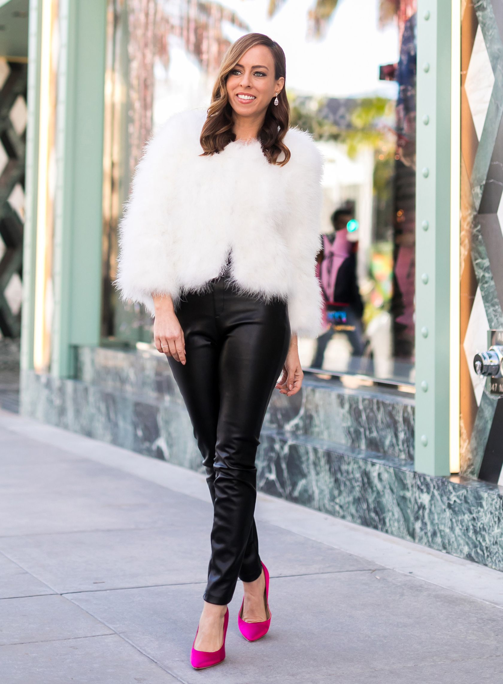 612e6a7e4 Sydne Style shows how to wear the feather trend for holiday parties in  white fuzzy coat and leather leggings  fur  leather  leatherleggings   holiday   ...