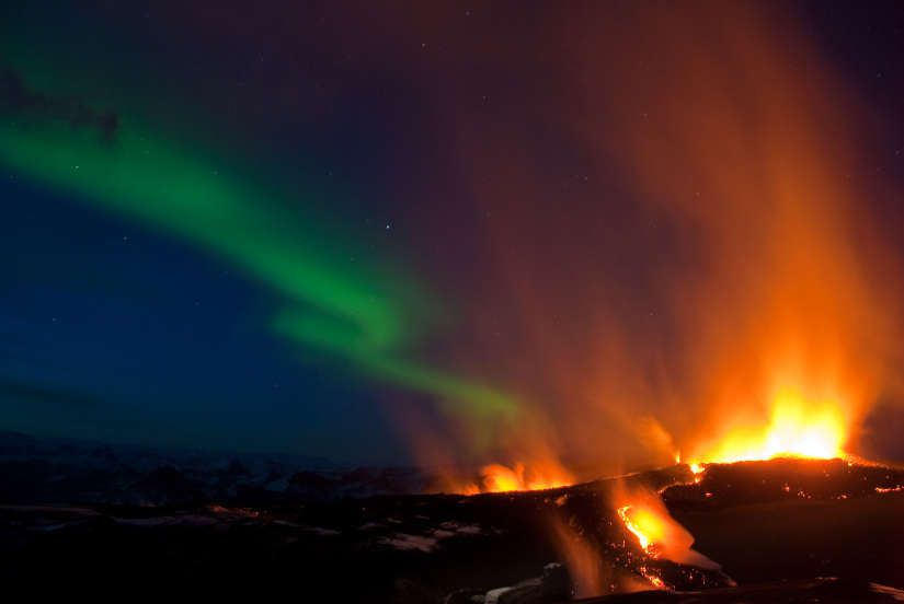 Stunning 2010 eruption of Eyjafjajokull volcano with aurora background.