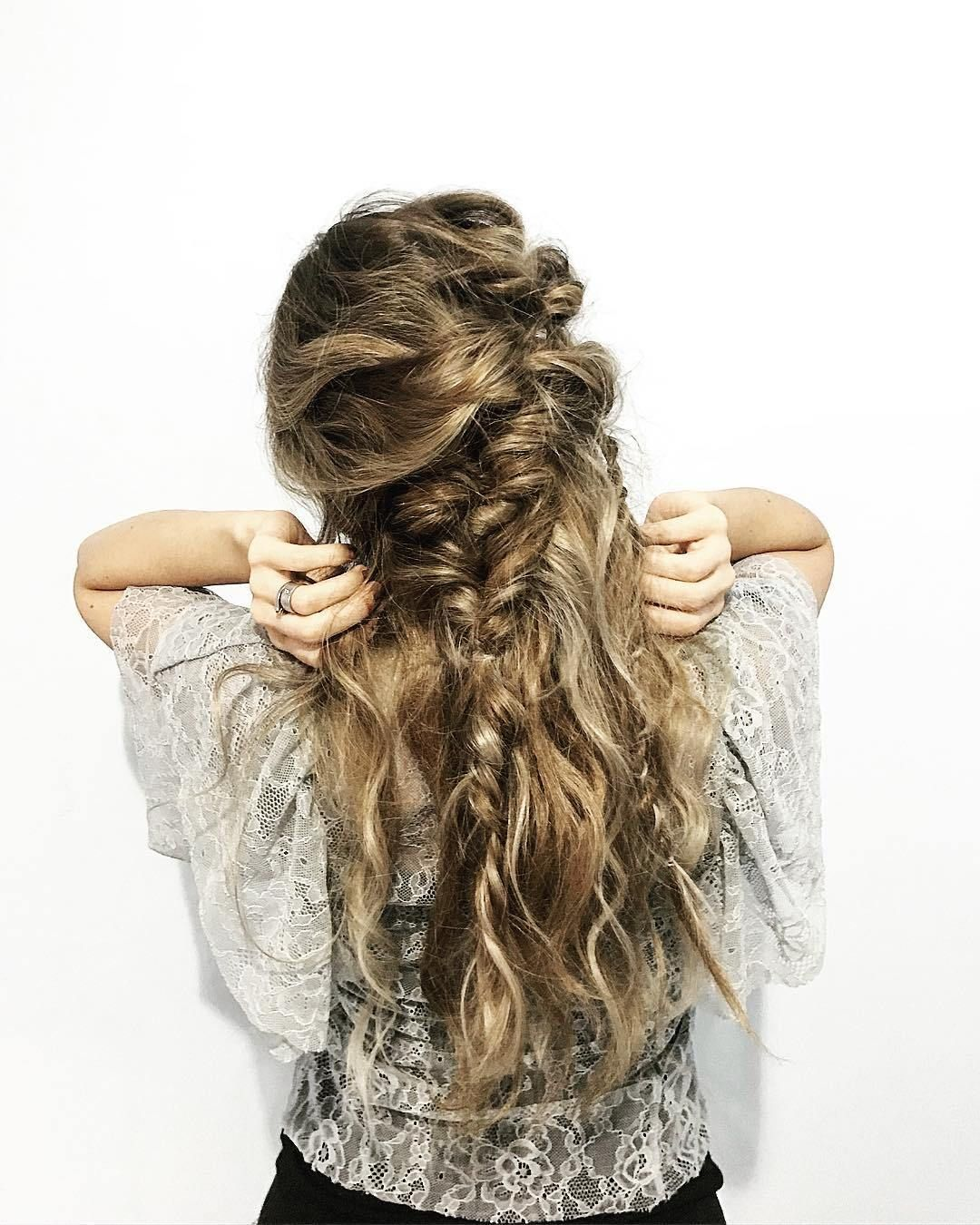 Creative messy braid half up half down hairstyle