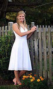 senior girl by fence