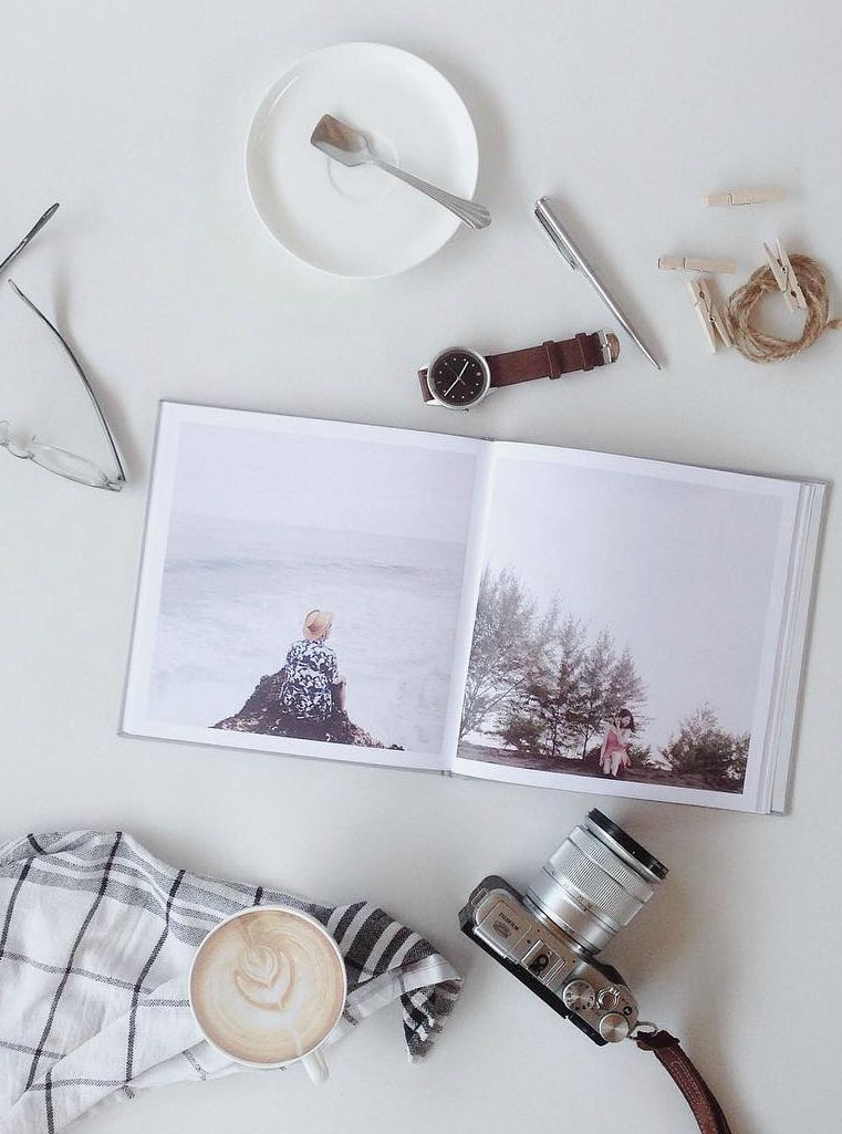 Moments are to be treasured... Preserve yours in a tangible format for generations to come. Create your own photo book with Instagram photos.  Gorgeous flat lay coffee style picture.