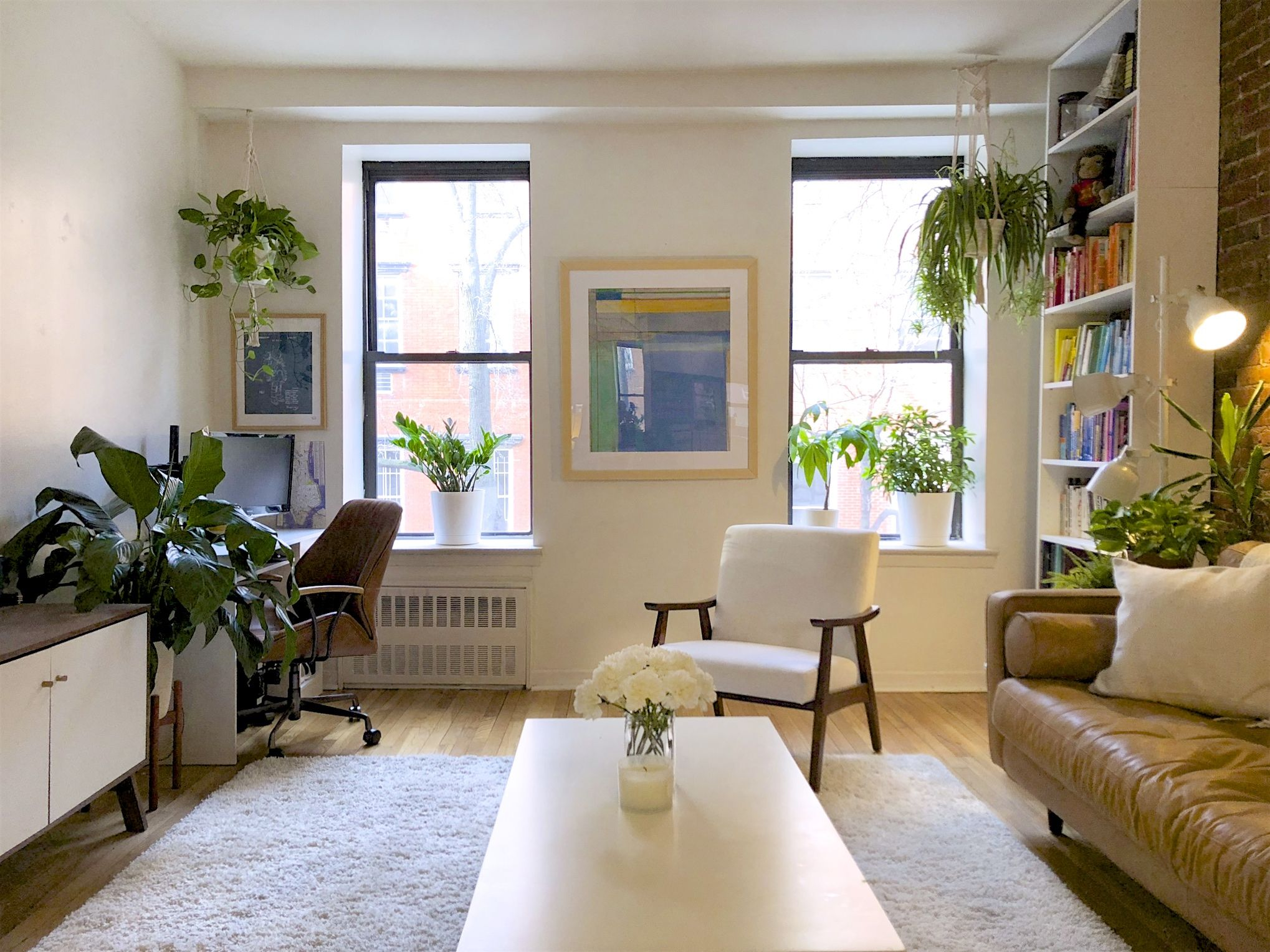 A Small Nyc Apartment Has The Cutest Simple Plant Display Above The Bed Tiny Living Rooms Desk In Living Room Nyc Apartment #studio #apartment #living #room