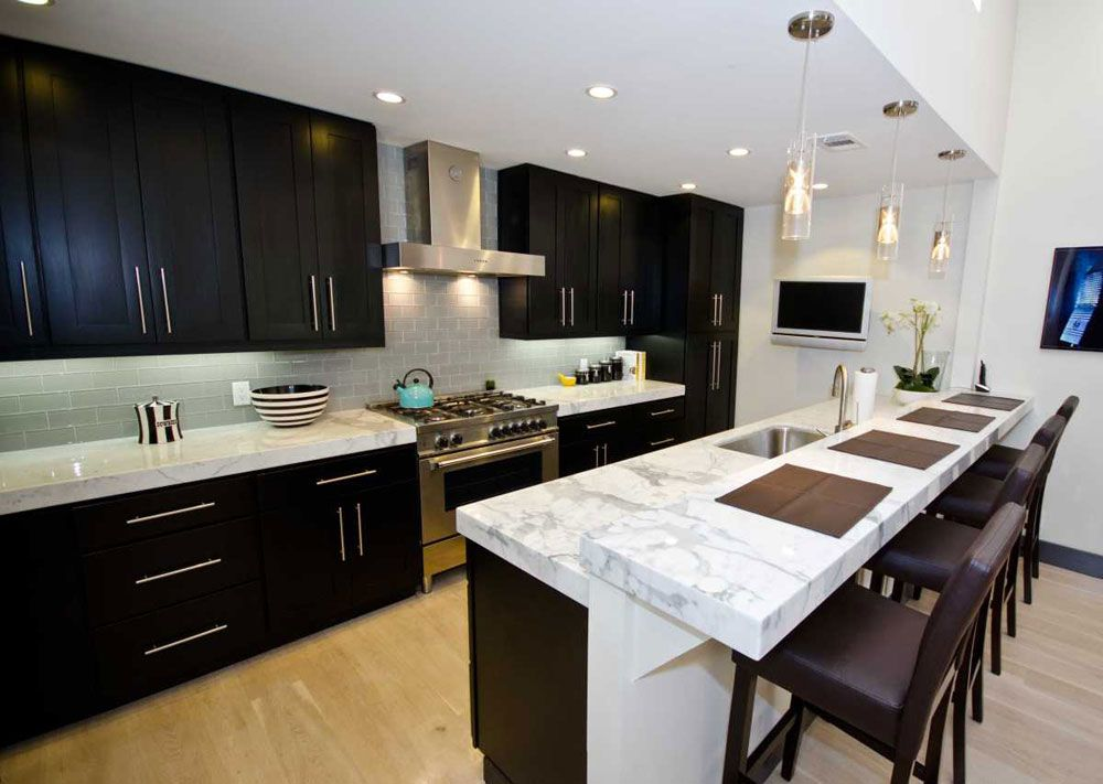 White Carrara Marble Countertop With Dark Cabinets