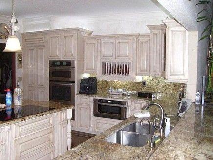 cream color kitchen cabinets and slate floor  Vanilla Cream