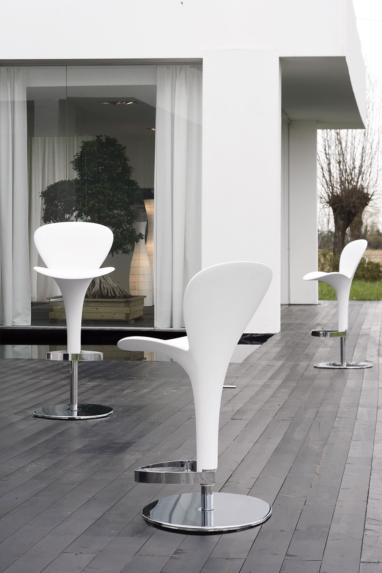 Calice stool made by injection technology of polyurethane for the creation of a unique product which may be personalized by choosing the color most akin to one's fantasy for the padded seating. Calice is aesthetic beauty for both the domestic environment and the most demanding contract request.