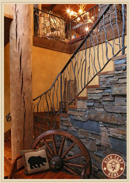 handcrafted wrought iron balusters in a twig design and stacked slate makes the staircase