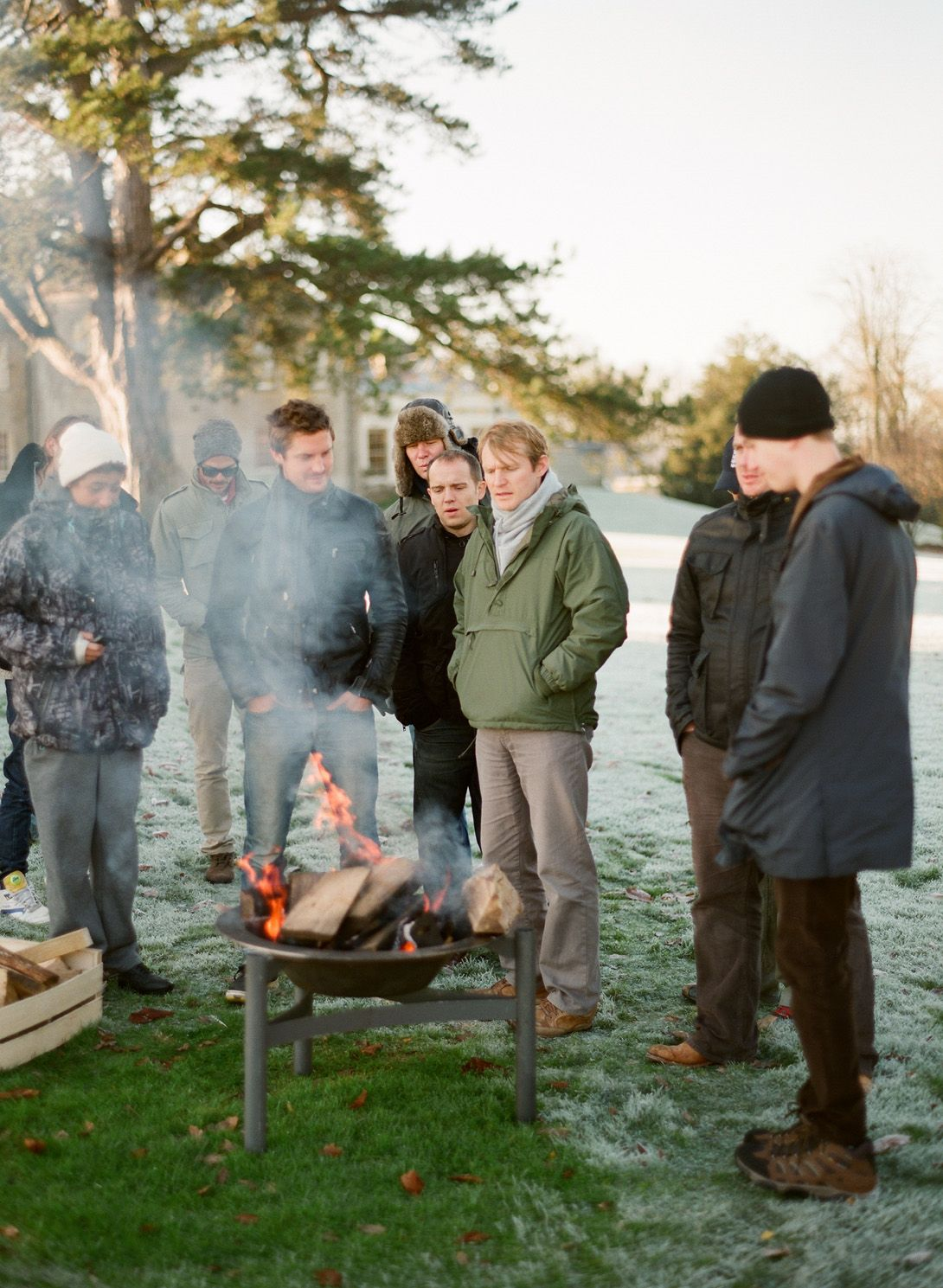 The Lads Gathered Around An Early Morning Fire To Help Warm Them
