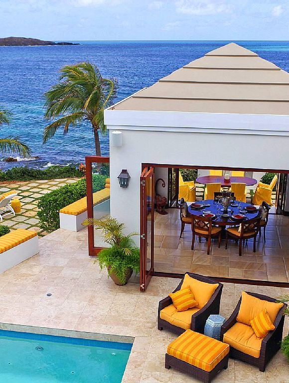 Luxury on the water's edge. Island view. For more #StCroix #vacationrentals go to:  http://villamargarita.com/st-croix-vacation-rentals/  #villamargarita #StCroixRealEstate #USVirginIslands #USVI #dreamhomes #STX #caribbean #USVIproperty #stx #virginislands #beachfronthomes #villas #stcroixbeaches #travel #holiday #StCroixVillas