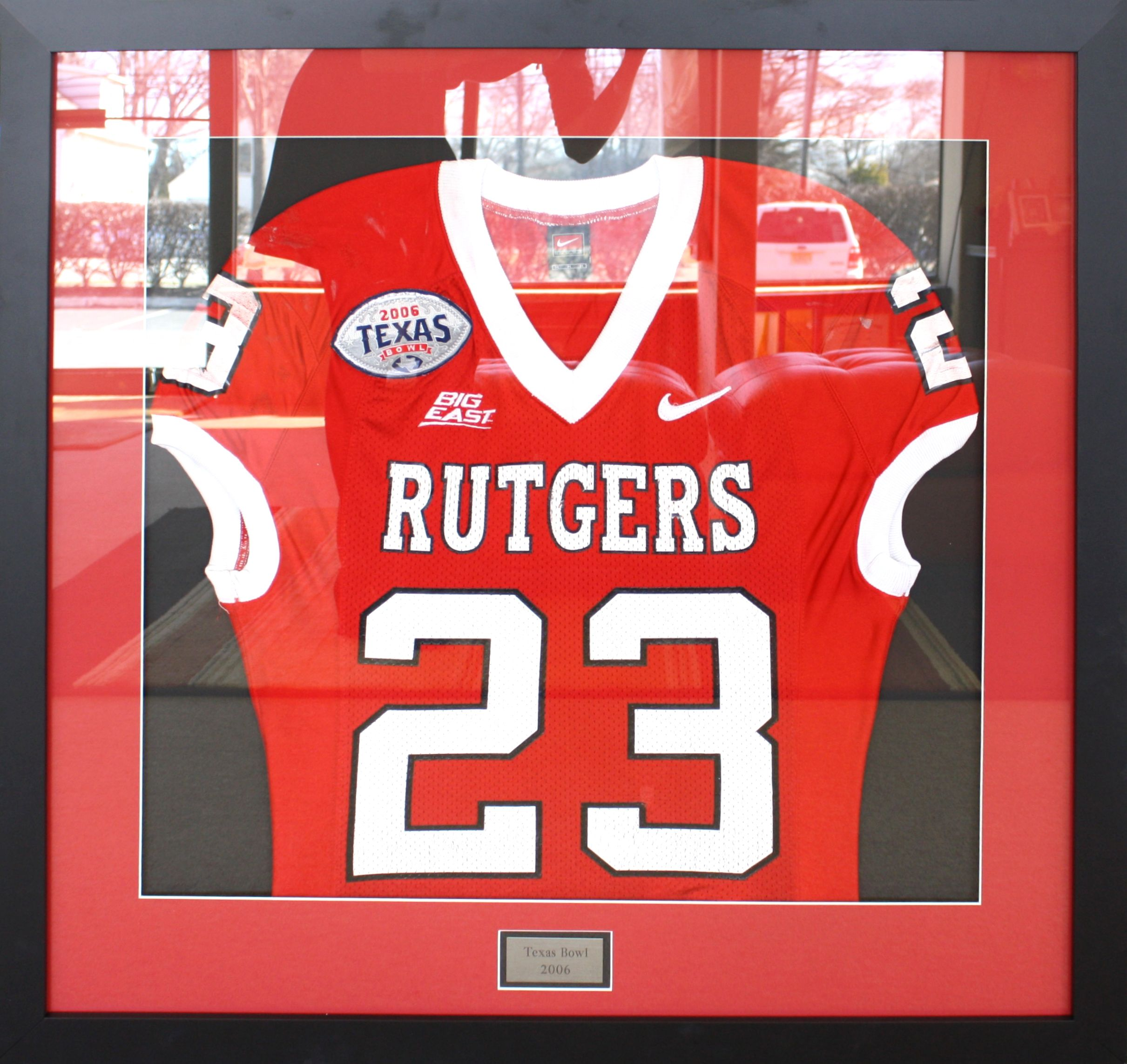 3ddd4d7b7b1 Rutgers Football Jersey displayed in a black frame with a name plate and  red and black mats. Designed and framed at My Framing Store in Edison, NJ.