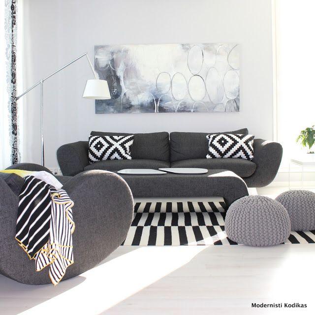Grey sofas   knit pouffes   striped rug and throws   modernistikodikas