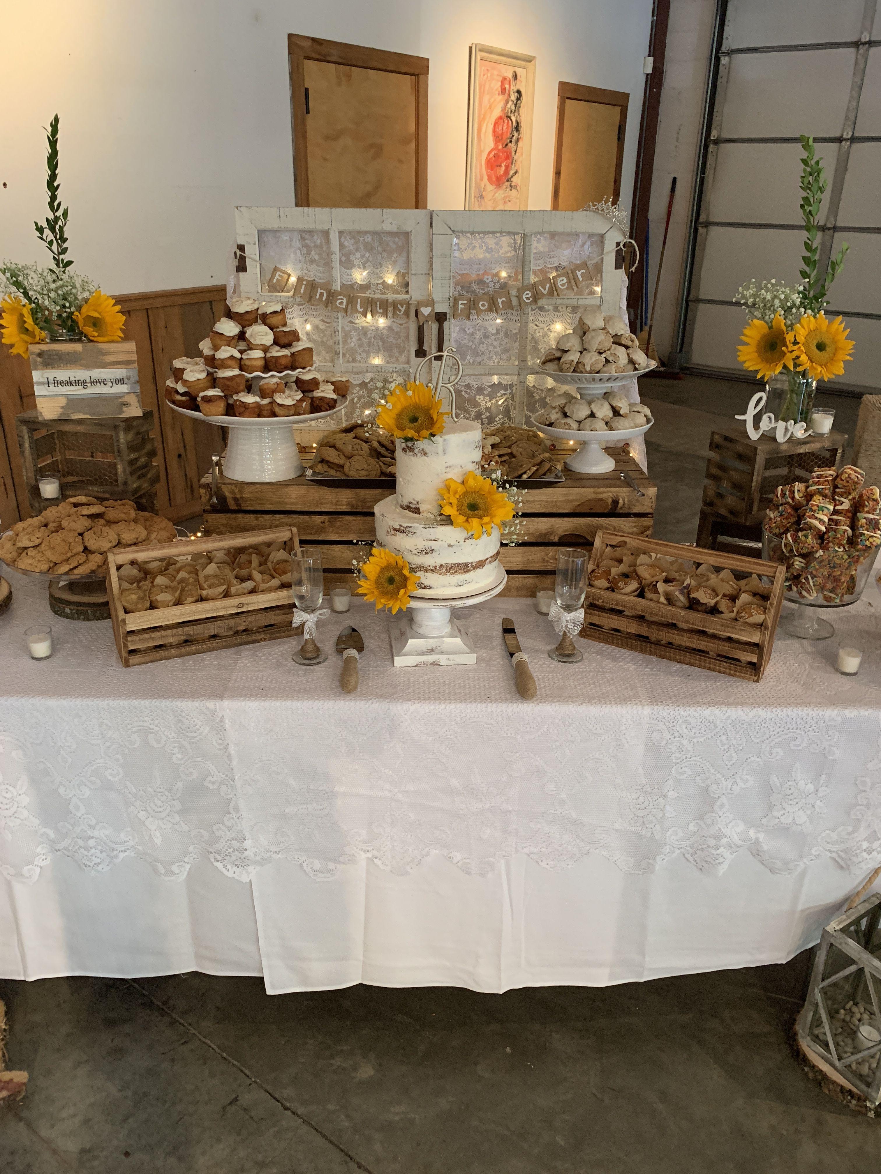 Rustic wedding dessert table with sunflowers Wedding