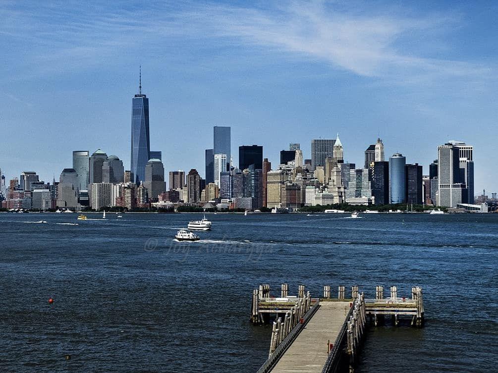 Manhattan Skyline From Way To Ellis Island Manhattan Skyline Skyline Landscape Photography