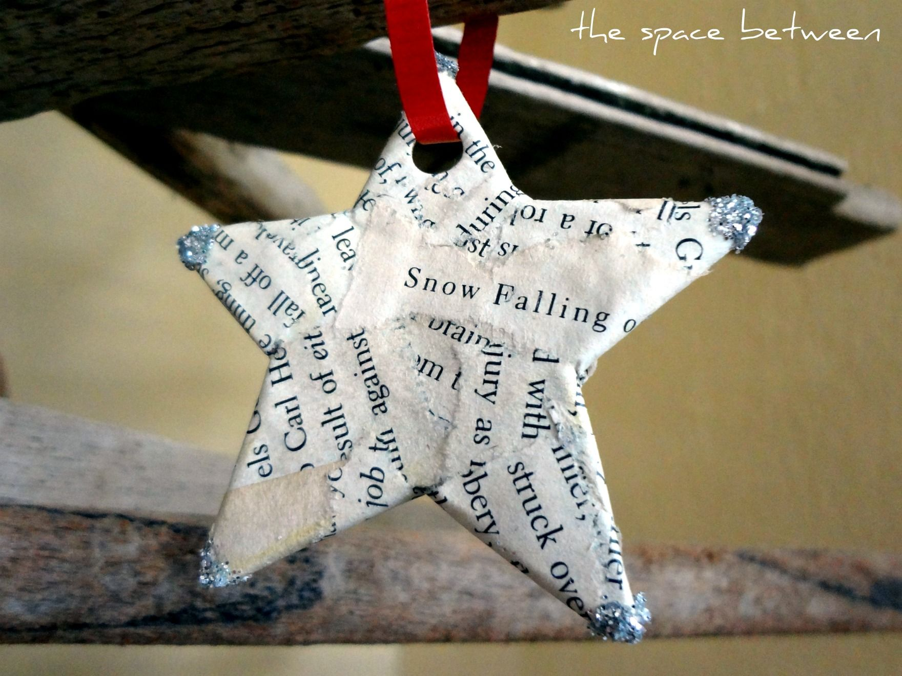 old book pages cover a cardboard cut out star ornament - an easy