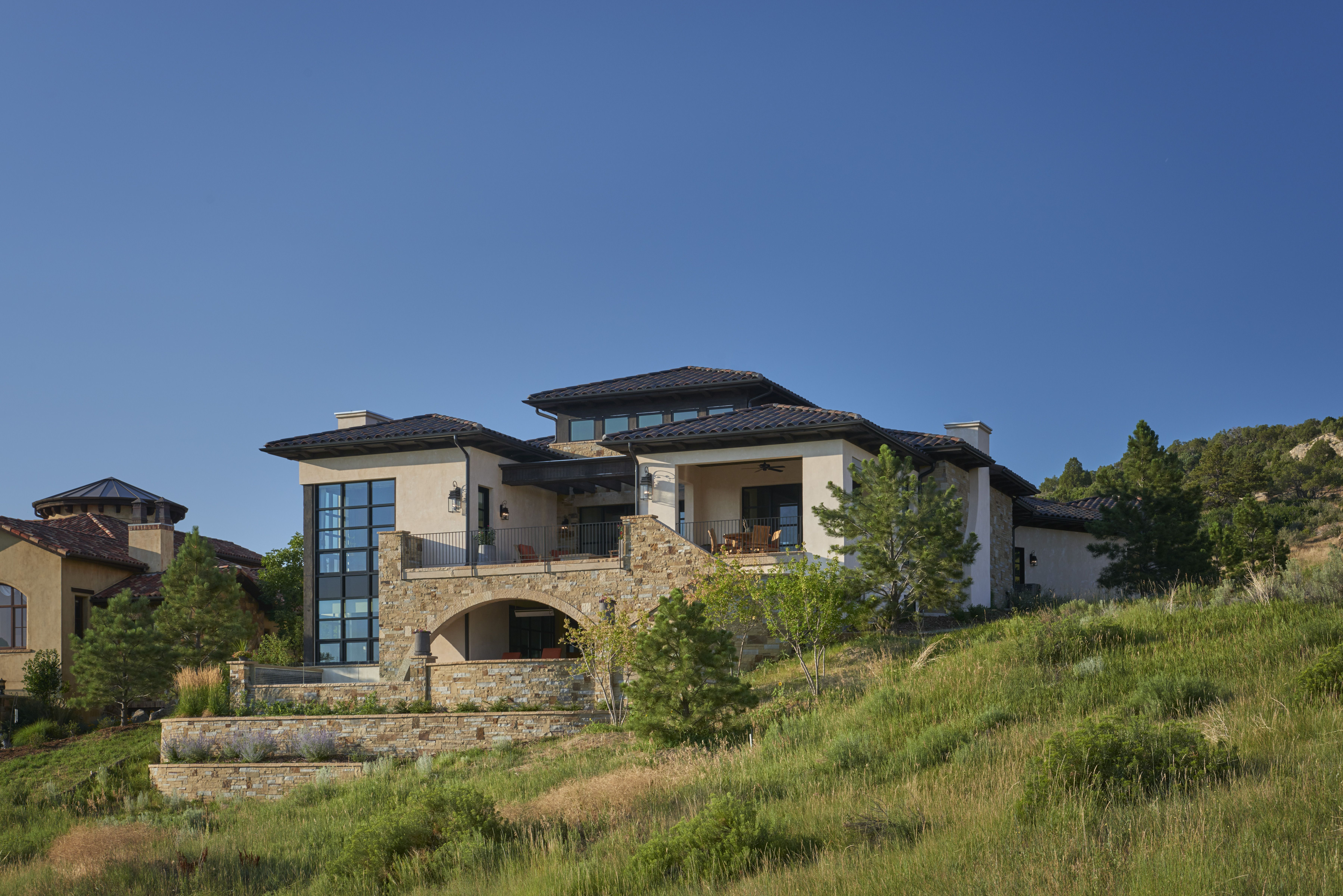 Exterior of the beautiful Tuscan home that sits looking out for a great view of the mountains and golf course!