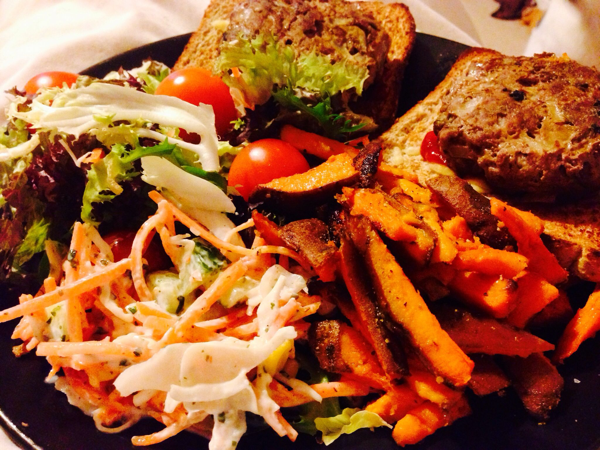 Homemade burgers, sweet potato fries, coleslaw, wholemeal bread and salad.   Burgers  Lean mince beef, (500g makes 4 burgers) 1 egg, 1 onion finely chopped, 2 tablespoons finely chopped coriander,  1/2 teaspoon garlic powder, 1/2 teaspoon chilli powder, seasoning. Mix together, shape into burgers, bake 40 mins.  Sweet potato fries  1 large sweet potato thinly chopped, boil 10 mins, olive oil, grill 20 mins.  Coleslaw  1Grated carrot, grated cabbage, coriander, fat free natural yogurt.