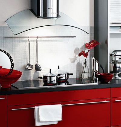 Once Boxy And Bland, Stove Hoods Are Taking Center Stage With Curvy,  Sculptural Shapes