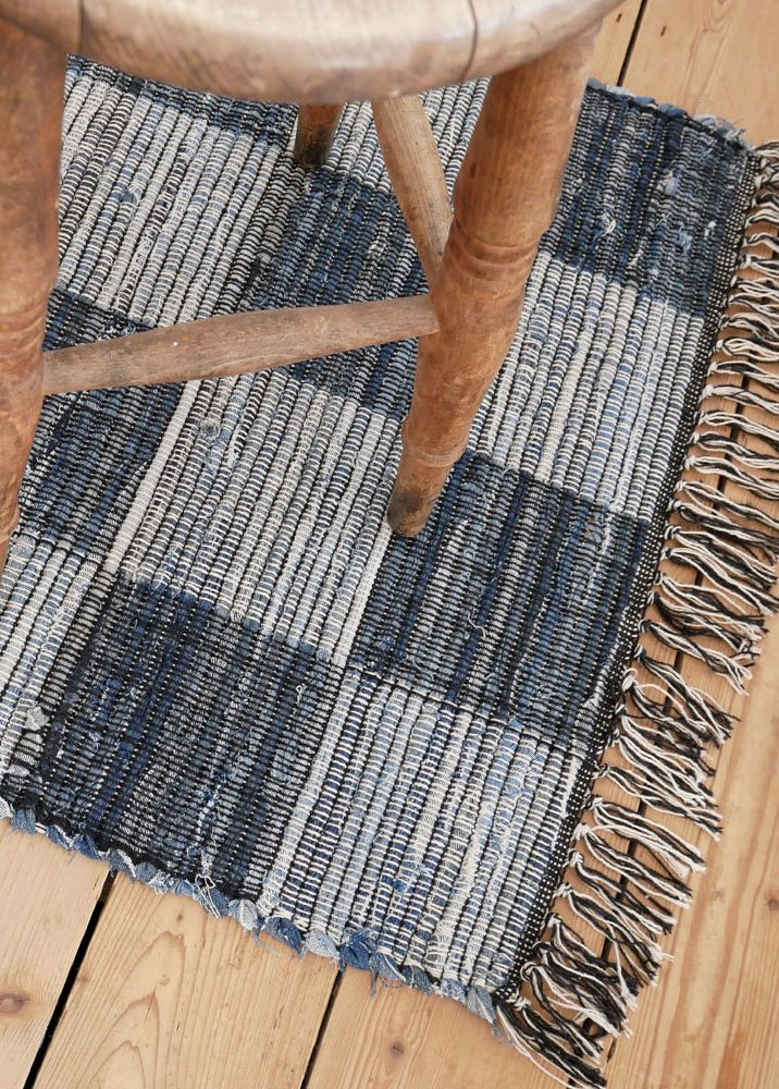The Viggo Blue Black And White Check Rug Is A Scandi Interior Favourite Complete With Fringing It Will Warm Up Any Wooden F Cotton Rug Rugs Scandi Interiors