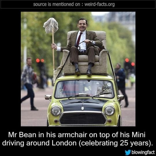 Mr Bean in his armchair on top of his Mini driving around London (celebrating 25 years)