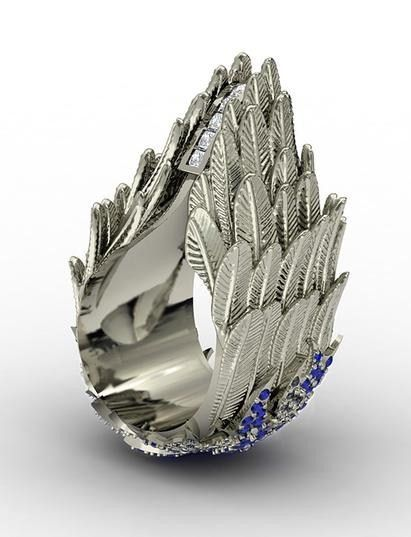 asmine Alexander Ascent Victorious white gold ring with sapphires and diamonds.