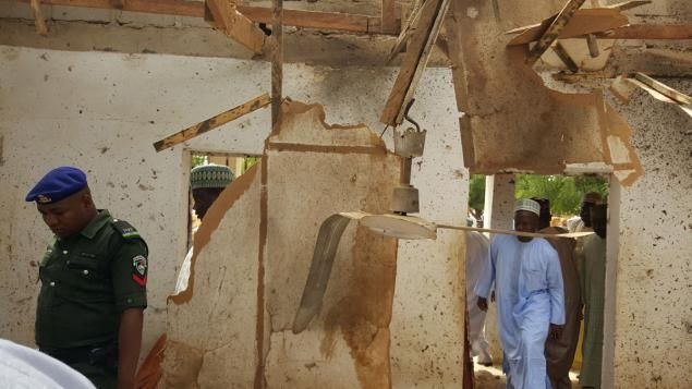People inspect a damaged mosque following a suicide bomb explosion in Maiduguri, Nigeria Wednesday.