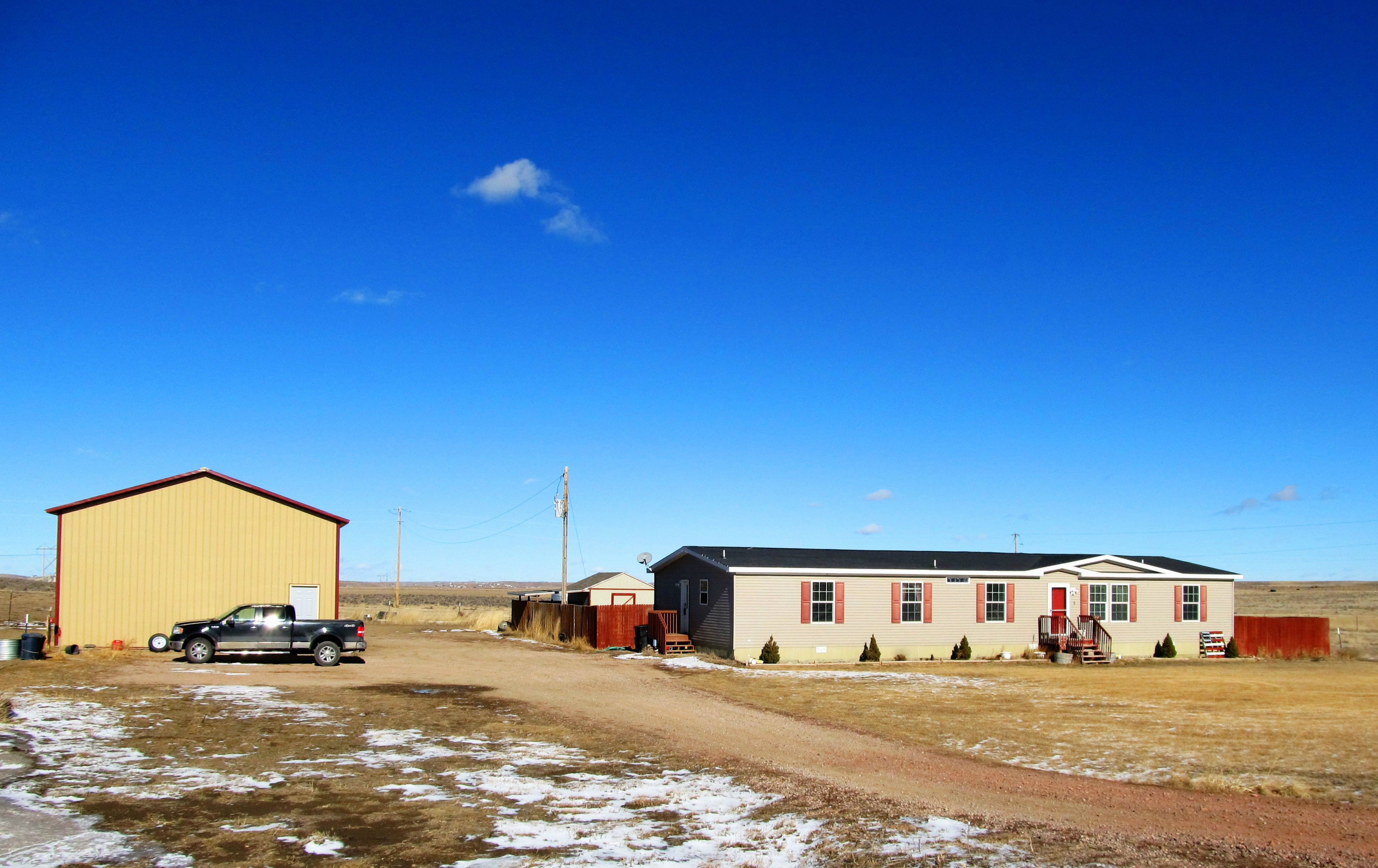 5 Mutton Bustin St. in Gillette offers 5 fenced acres, a