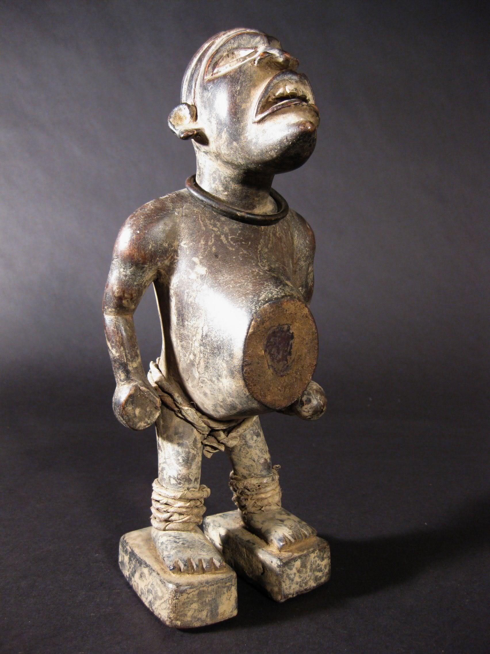 Bakongo nkisi figure with rattle d r ngo wood metal