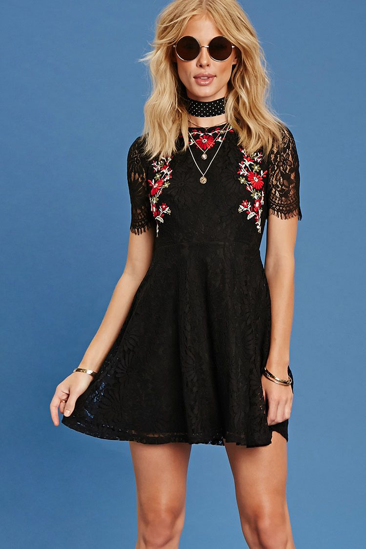 A knit eyelash lace dress with floral embroidery on the front short