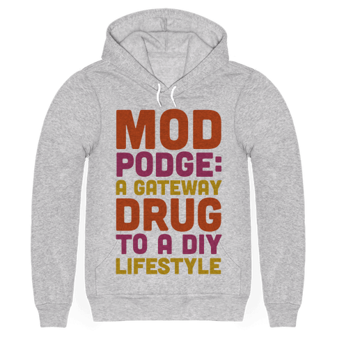 """Decoupage is a hard habit to kick. Get them hooked on hobbies at a young age with this craft inspired design. This orange yellow and magenta shirt features the phrase """"Mod Podge: a Gateway Drug to a DIY Lifestyle."""" This shirt is perfect for any fan of crafts, D.I.Y. or scrapbooking."""