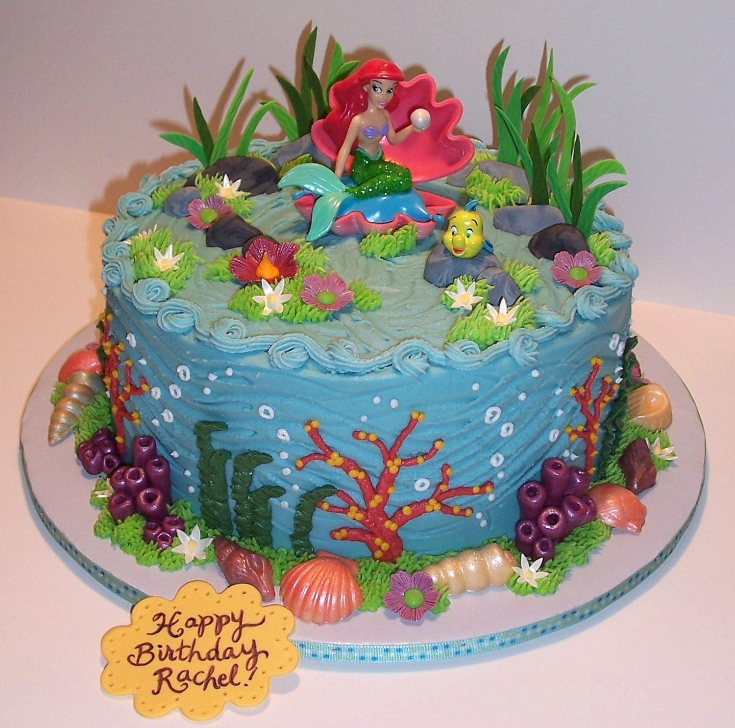 A Mermaids Tale Pound cake with buttercream and gumpaste