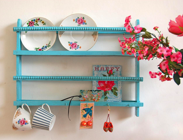 turquoise shelves + pretty cups and plates... I would die to have this in my kitchen someday.